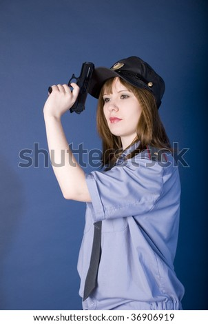 young women policeman fulfill receptions of shooting from a pistol - stock photo