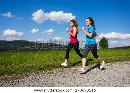 Young women running - stock photo