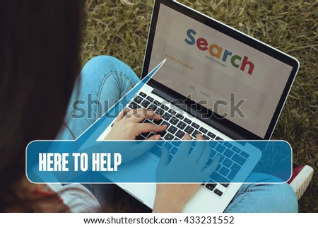 Young women sitting on the grass on a Tablet PC is searching for Here To Help.