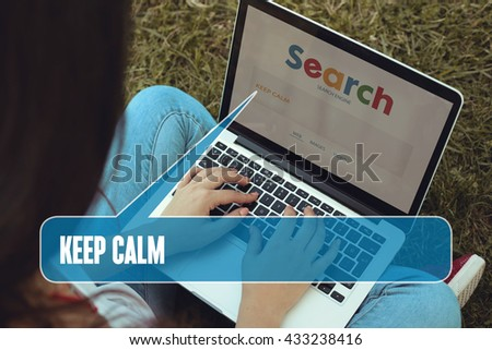 Young women sitting on the grass on a Tablet PC is searching for Keep Calm.