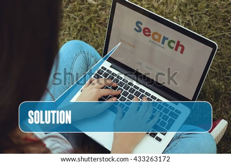 Young women sitting on the grass on a Tablet PC is searching for Solution.