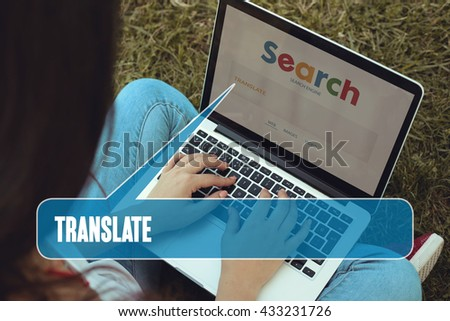 Young women sitting on the grass on a Tablet PC is searching for Translate.