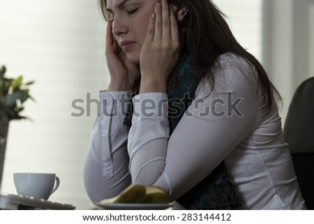 Young women suffering from acute migraine - stock photo