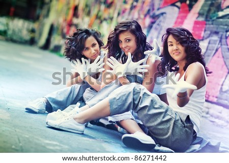 Young women team. Focus on central woman. - stock photo