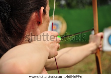 Young women training with the bow - stock photo