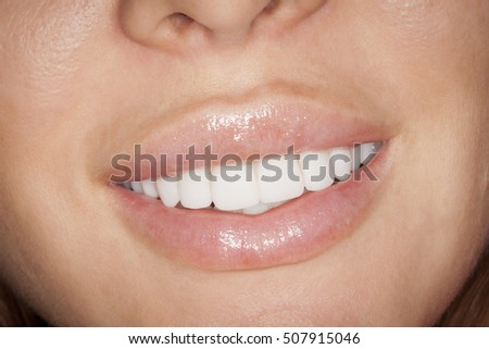Young women white teeth smile with lipstick