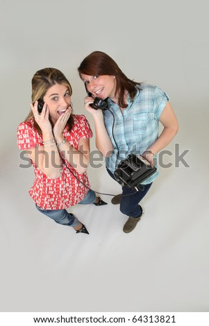 Young women with a landline phone - stock photo