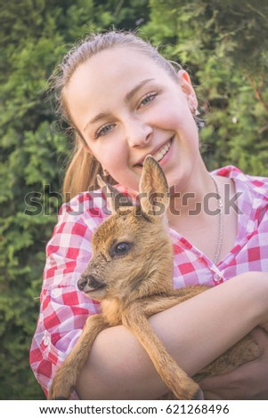 Young women with a little deer