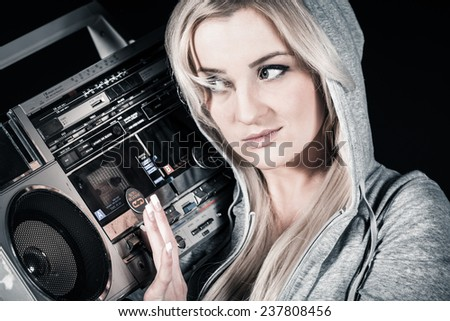 Young Women with old tape recorder - stock photo