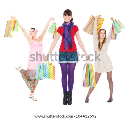 young women with shopping bags against white background