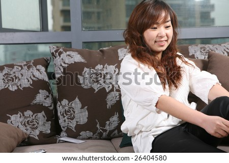 young women with sofa at home - stock photo
