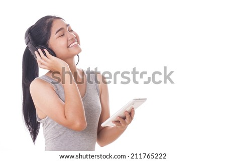 Young women with tablet pc and headphones.  - stock photo