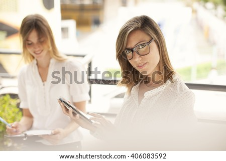 Young women working outdoors - stock photo