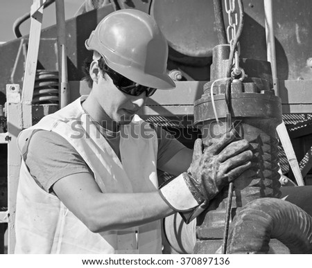 young worker at work with the pump