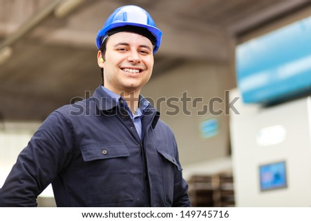 Young worker in a construction plant - stock photo