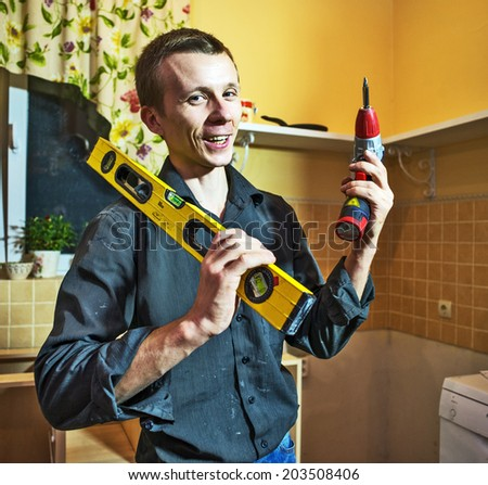 young worker man with tool in citchen interior. - stock photo