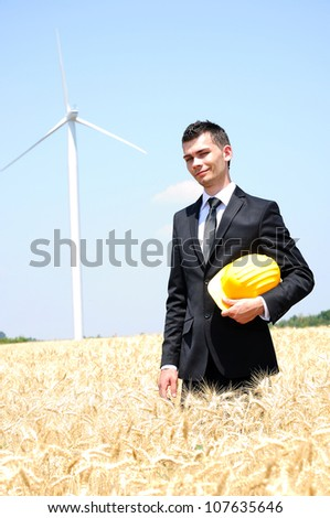 Young worker on wind farm - stock photo
