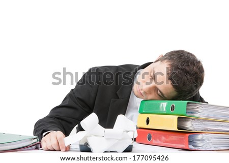 young worker sitting at desk and sleeping. tired and exhausted businessman lying on folders - stock photo
