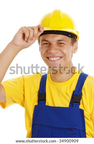 Young worker taking off his yellow hard hat and smile, isolated over white - stock photo