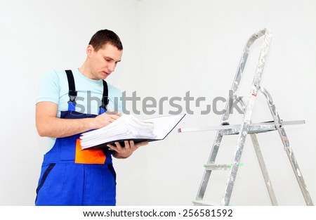 Young worker with documents - stock photo