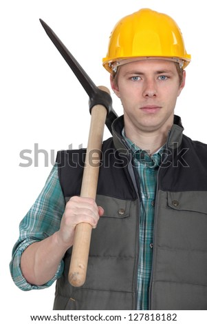 Young worker with pick-Axe - stock photo