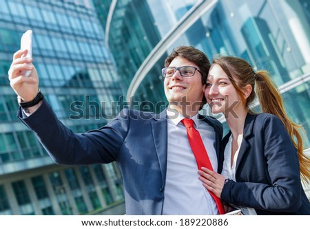 Young working colleagues photographing themselves - stock photo