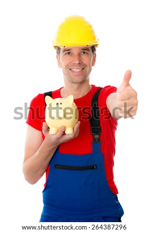 young workman with thumb up is showing a piggy bank - stock photo