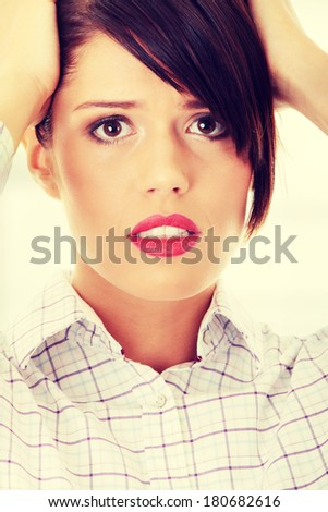 Young worried business woman - stock photo