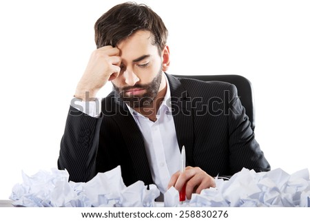 Young worried businessman can't find an idea. - stock photo