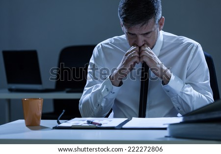 Young worried businessman preparing for presentation - stock photo