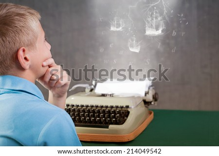 young writer thinking and imagination what to write on retro typewriter - stock photo