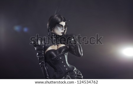 Young yellow eyed witch in black Victorian costume - stock photo