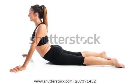 Young yoga female posing - stock photo