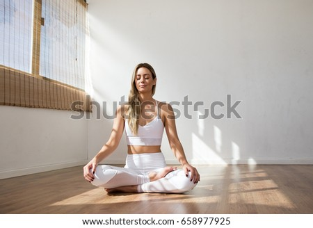 young yoga woman meditating peacefully white stock photo royalty rh shutterstock com Learning Basic Yoga Yoga Poses for Beginners