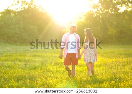 young young couple in love having fun and enjoying the beautiful nature