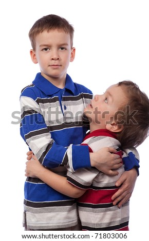 Younger brother looks at his big brother - stock photo