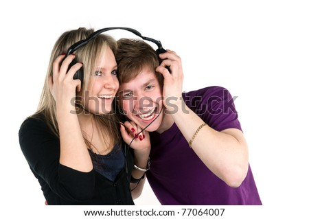 younger pair listens music in headphones - stock photo