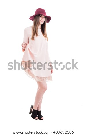 Youngh beautiful girl in nude summer dress and trendy footwear looking charming on white studio background - stock photo