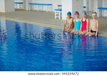 Youngsters in swimming pool - stock photo
