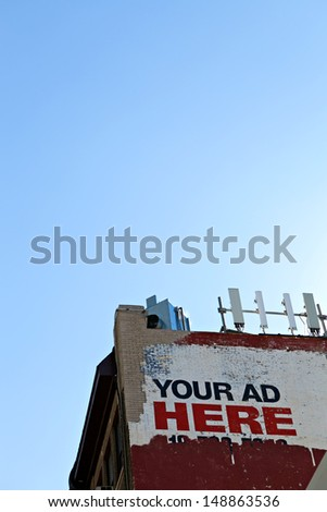 Your ad here sign as seen on the side of an old city building. Plent of copy space for your text or mockup ad design. - stock photo