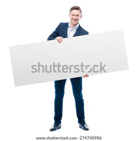 Your advertisement in good hands. Handsome young business man holding big blank with copy space. Isolated on white. - stock photo