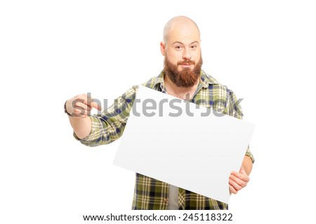 Your advertisement may be here! Cheerful young man with long beard holding a white board and pointing it while standing isolated against white background - stock photo