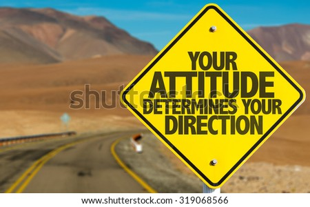Your Attitude Determines Your Direction sign on desert road - stock photo