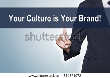 Your Culture is Your Brand Business woman pushing hand on virtual screen for e-commerce background - stock photo