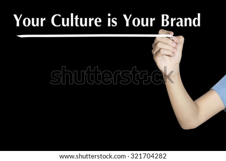 Your Culture is Your Brand Woman writing word with black screen - stock photo