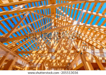 Your dream home. New residential construction house framing - stock photo