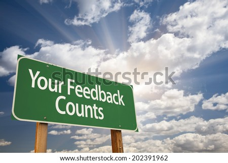 Your Feedback Counts Green Road Sign with Dramatic Clouds and Sky.
