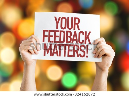 Your Feedback Matters placard with bokeh background - stock photo