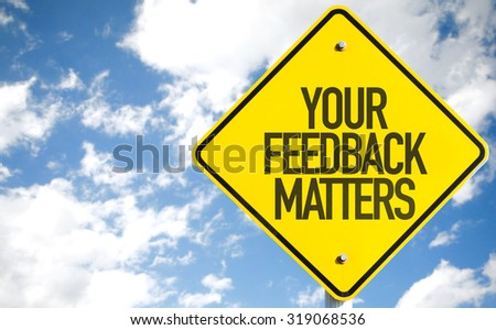 Your Feedback Matters sign with sky background - stock photo