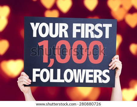 Your First 1,000 Followers card with heart bokeh background - stock photo